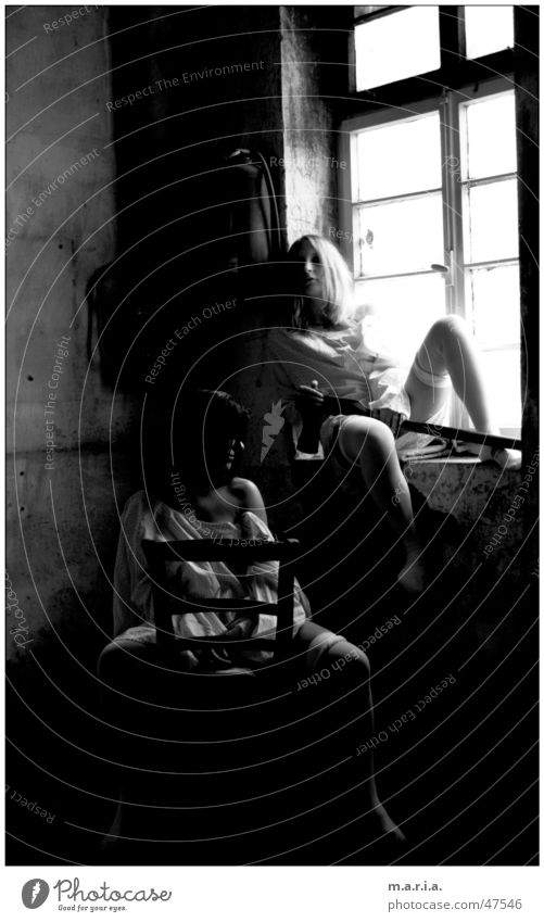 thelma&luise1 Woman Axe Window Light Shoulder Warehouse Dark Location Portrait photograph Human being Chair Skin Legs Black & white photo