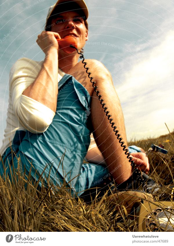 Telephoning in nature Telephone Analog Meadow Summer Portrait photograph String Human being Laughter Audience Listening capy grass Sit