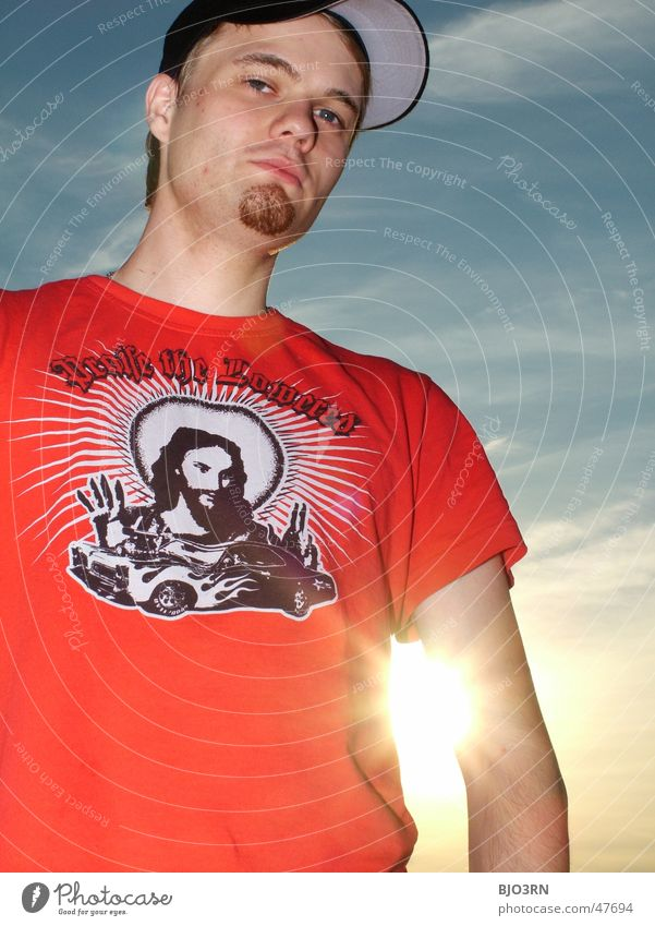 Man Sky Sun Clouds Black Freedom Orange Cool (slang) T-shirt Facial hair Cap Christianity Jesus Christ Fellow Goatee Headwear