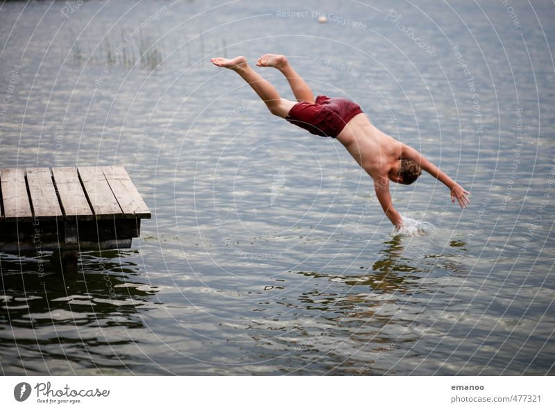 Reaching into the lake Lifestyle Style Joy Swimming & Bathing Leisure and hobbies Vacation & Travel Freedom Summer Beach Human being Masculine Boy (child)