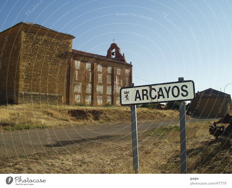 arcayos Spain Arcayos Foreign countries South Cemetery Church yard Street sign Country road Traffic lane Exterior shot Red Brown Beige Physics Summer Gloomy