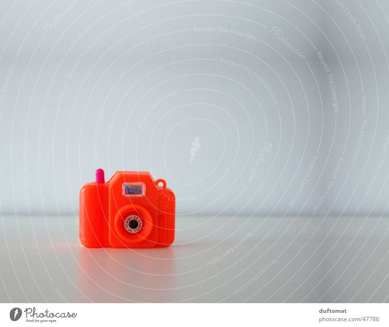 MiniPhoto Miniature Neon light Red Toys Clack Take a photo Photography Viewfinder Small Camera Orange photo camera Calm Focal point