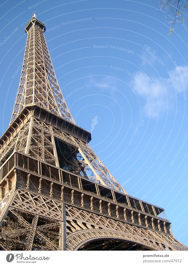 Eiffel Tower in Paris. Photo: Alexander Hauk France Tourism Manmade structures Steel Art Metal Tourist Attraction vacation free time Sky Blue Clouds
