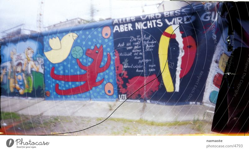 Graffiti Berlin Wall (barrier) Art Monument Landmark Figure of speech Relief Symbols and metaphors