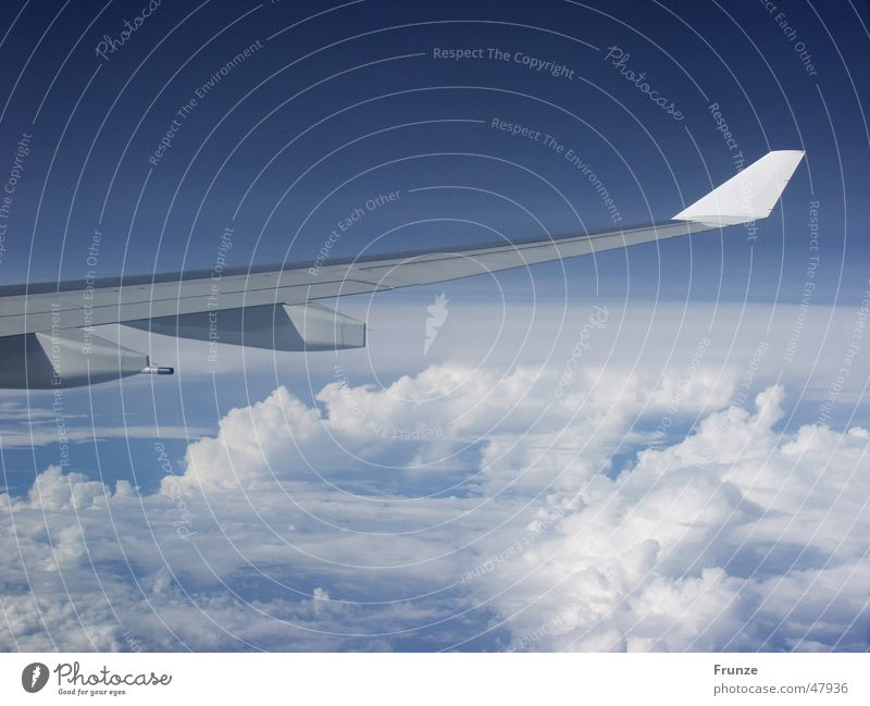 Sky Blue Vacation & Travel Clouds Airplane Flying Aviation Wing Airplane landing