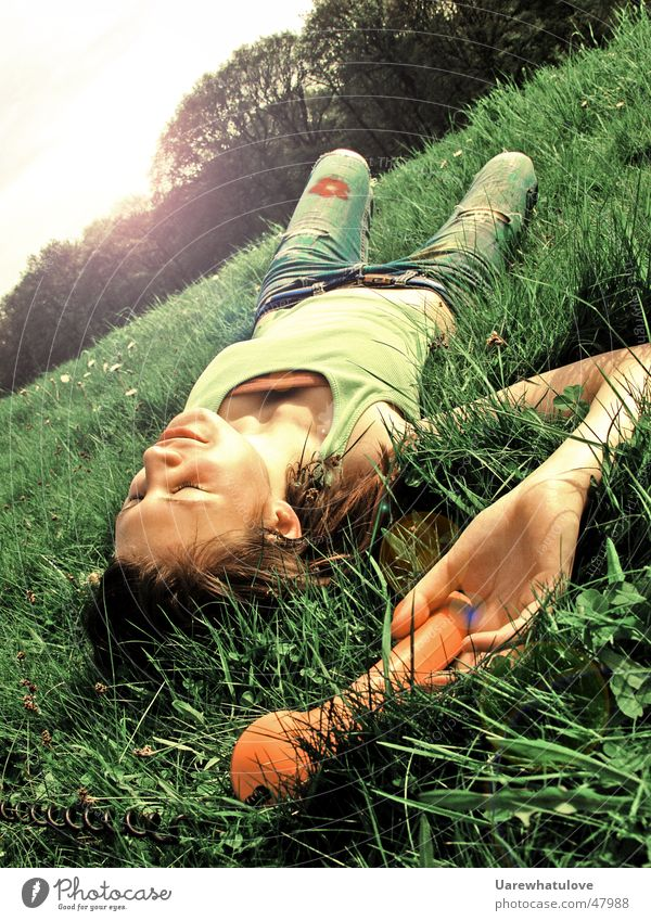 Sunshine is calling Telephone Woman Meadow Field Forest Green To enjoy Relaxation Audience Lie Orange flower Nature Laughter grass Tilt