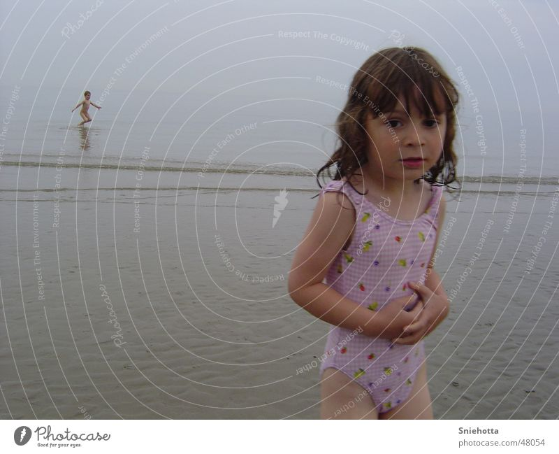 Joy in the background Child Ocean Beach Girl Freeze Hop
