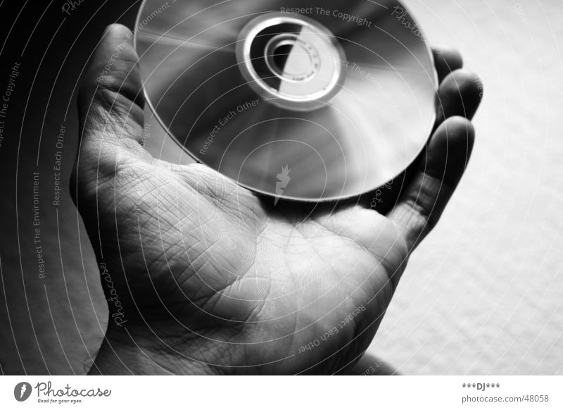data transfer CD Hand Thumb Fingers Multimedial Media Data storage Reflection compact disc Black & white photo Shadow