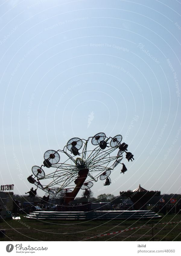 now it's going round and round Fairs & Carnivals Back-light Village fair carousel Markets Sky Joy