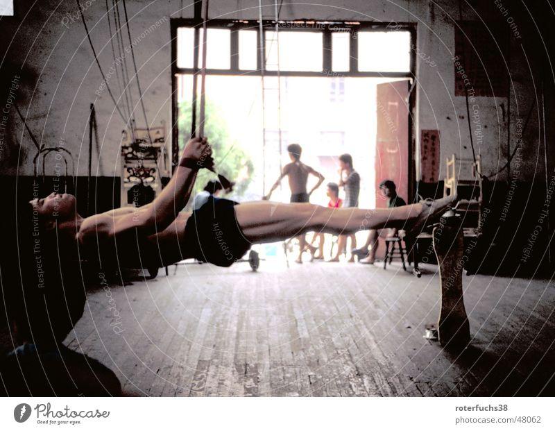 Human being Power Crazy Rope Gate China Warehouse Effort Musculature Acrobat Clown Wooden floor Gymnastics Horizontal Lacking Acrobatics