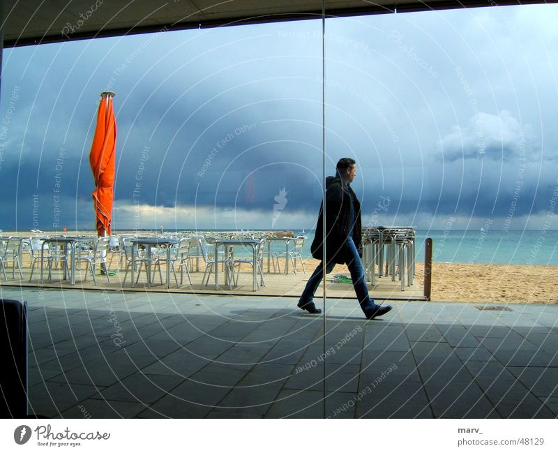 Barcelona 2005, the sky dark, the screen light Clouds Ocean Spain Beach Sunshade Café Sand