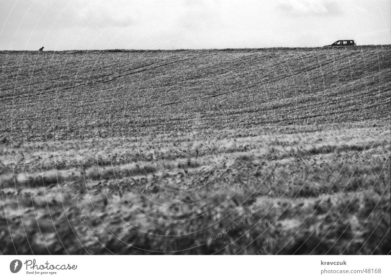 Car seeks owner Field Agriculture Hill Clouds Landscape format Horizontal Loneliness Crooked Grain Sky Black & white photo Floor covering Elevation