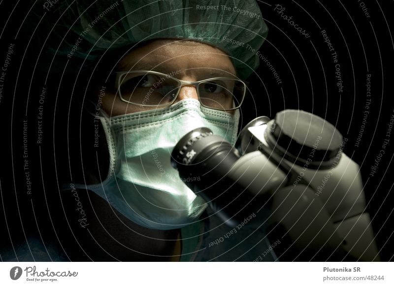 Dr. in the Dark Health care Doctor Eyeglasses Microscope Mask Colour photo Interior shot Detail Copy Space left Copy Space top Neutral Background
