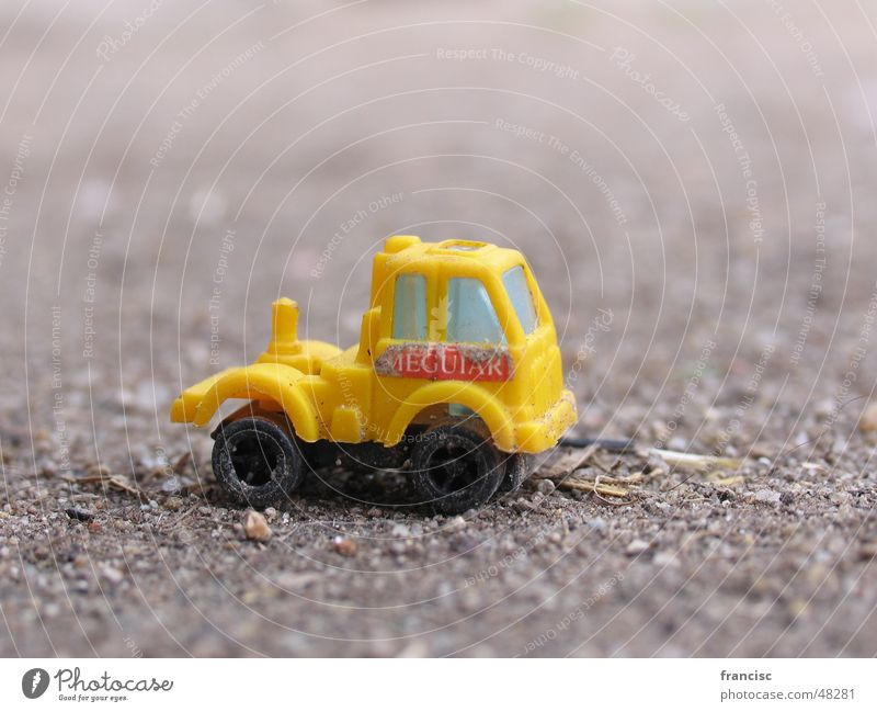 Little Truck Yellow Macro (Extreme close-up) Diffuse Design Vacation & Travel car machine sallow sad sandy little small plaything toy child game wheel blur Art