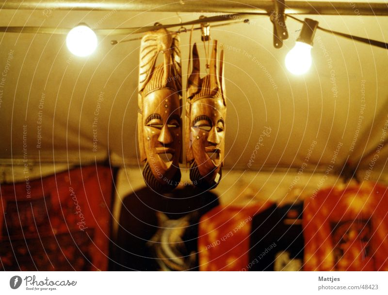 masks Africa Wood Chieftain Batik Peace festival Lamp Night Lighting Physics Narrow Event Markets Mask Tribal Tree trunk souveniers Stand Bright Warmth