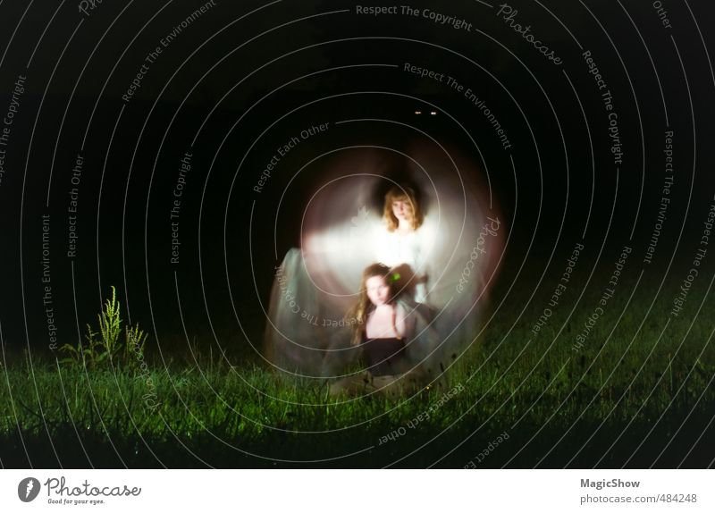 Two angels in the night Woman Adults Friendship 2 Human being Mysterious Magic Angel Fairy Meadow Motion blur Green White Illuminate Poverty Wing Light Dark