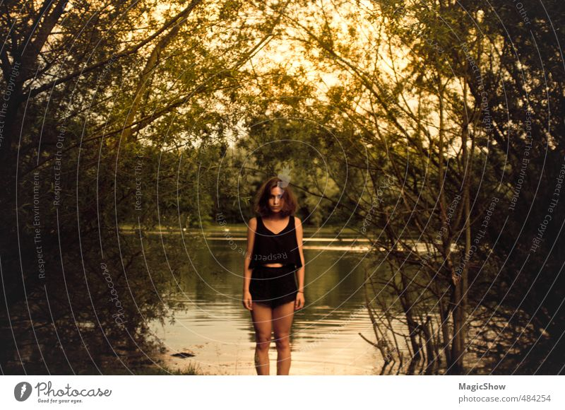 Woman at the pond Feminine Adults Skin 1 Human being Summer Warmth Garden Park Forest Bog Marsh Pond Lake Brunette Stand Leaf Dusk Green Yellow Hot pants