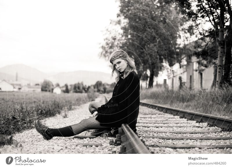 When's the train to take me away...? Young woman Youth (Young adults) 1 Human being Think Wait Beautiful Black Nostalgia Grief Railroad Railroad tracks Sit