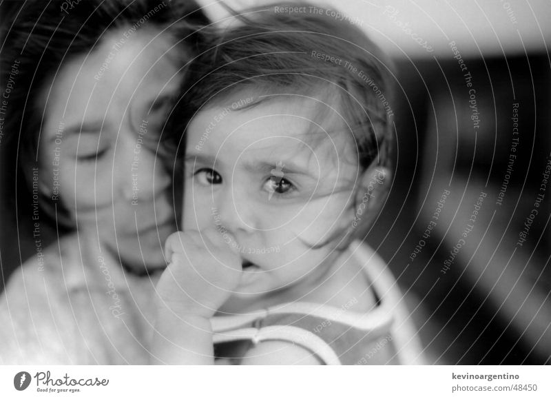 The daughters of Don Agüero Child Girl Thumb Strand of hair Black & white photo Eyes big eyes