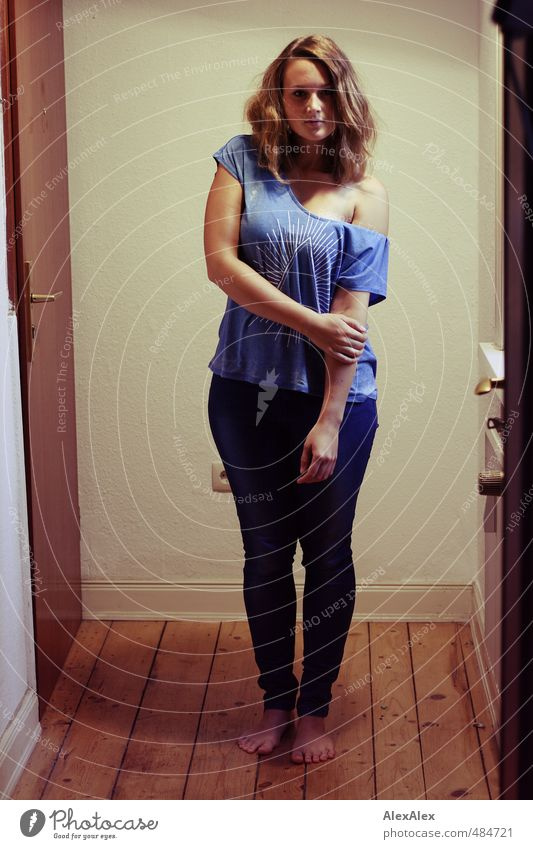 hipster queen!- young woman stands barefoot in a hallway Young woman Youth (Young adults) Body feet 18 - 30 years Adults Hallway Floorboards T-shirt Jeans