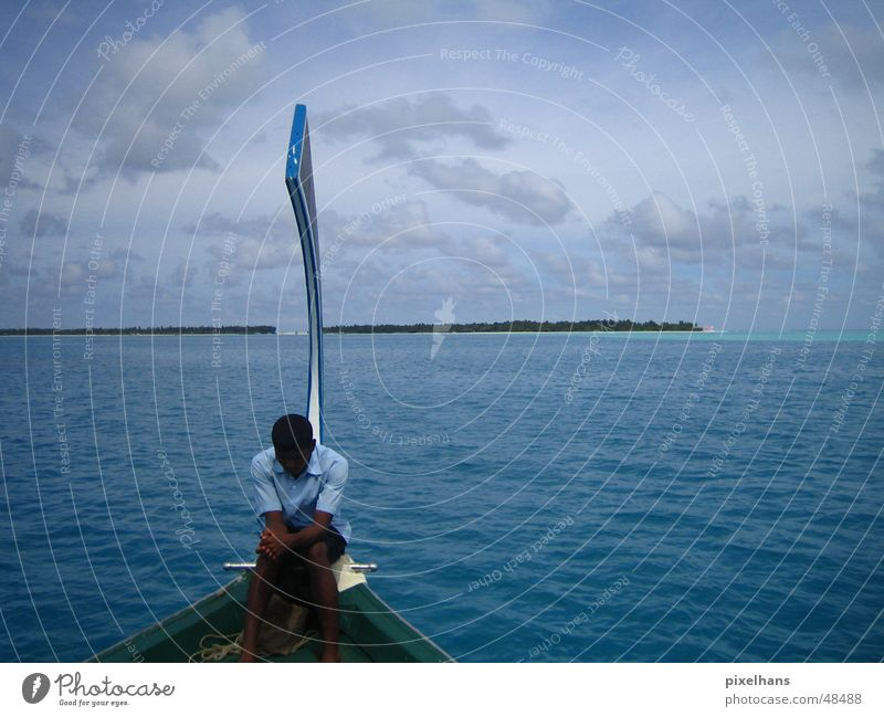 Human being Man Water Sky Blue Summer Clouds Watercraft Adults Horizon Island Travel photography Tradition Maldives Vacation photo Indian Ocean