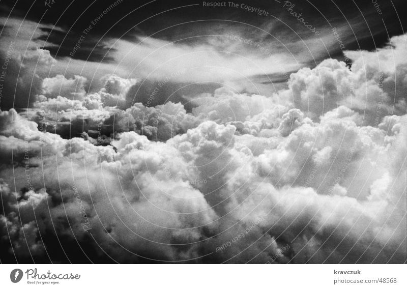 In another world Clouds Cumulus Far-off places Vantage point Sky Level Dramatic Black & white photo Contrast Aviation dohend Review