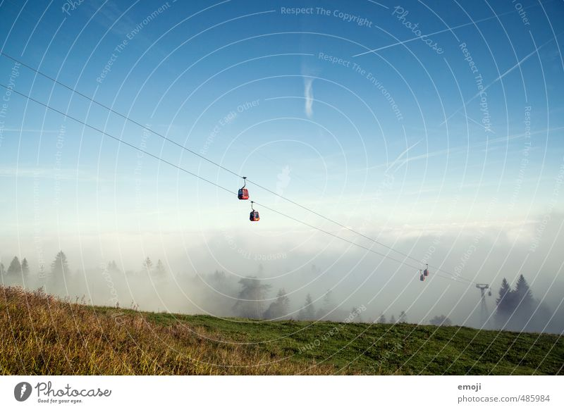 Out of the fog Environment Nature Landscape Sky Cloudless sky Autumn Fog Field Natural Positive Sea of fog Cable car Gondola Tourism Trip Hiking Colour photo