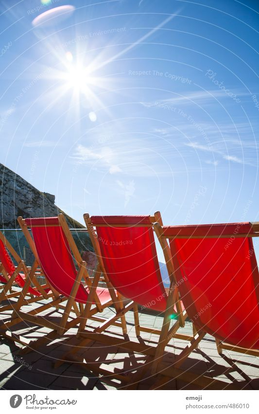 Place in the sun Environment Nature Sky Cloudless sky Sun Winter Beautiful weather Mountain Blue Red Deckchair Tourism Colour photo Multicoloured Exterior shot