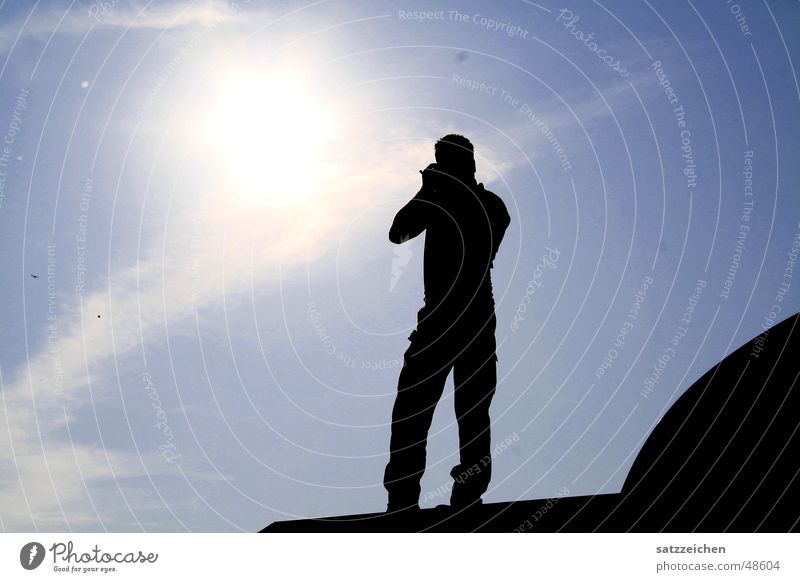 Photographer with sun in his heart Back-light Roof Clouds Infinity Man Flashy Light Sun sunshine Sky Focal point