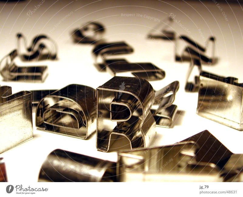 Metal Characters Letters (alphabet) Typography Silver Chaos Accumulation Aluminium Heap Chrome Toys Theater of war Latin alphabet Sand toys Page of text