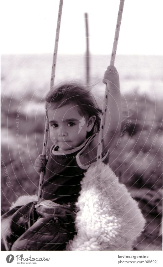 The daughter of Don Aguero Argentina Child Girl Swing Black & white photo