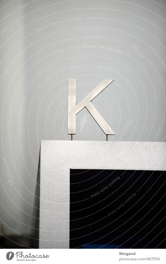 K question House (Residential Structure) Facade Sign Characters Signs and labeling Signage Warning sign Hang Gray Black Silver Far-off places Letters (alphabet)