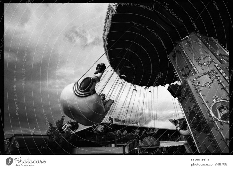 centrifugal Carousel Theme-park rides Fairs & Carnivals Chairoplane Child Contrast Black & white photo Rotate Detail Section of image Partially visible Swing
