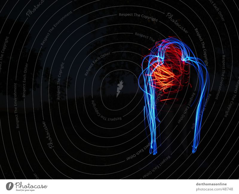 Blue man with heart Man Dark Tracer path Speed Action Muddled Swing Loneliness Stagnating Long exposure Heart Fiddle Strange Bordered Red Night Style Light Joy