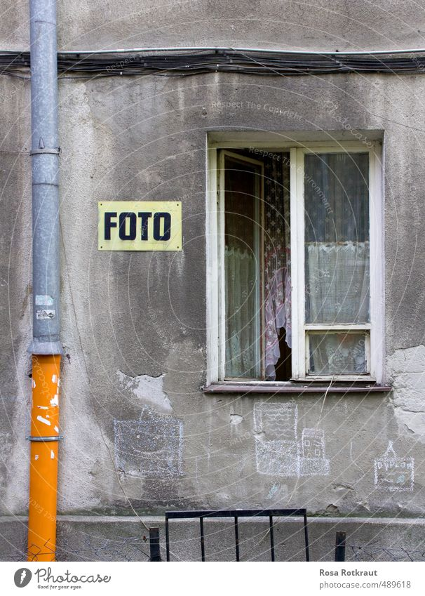 A photo is a photo. House (Residential Structure) Outskirts Wall (barrier) Wall (building) Window Concrete Signs and labeling Graffiti Line Old Esthetic Dirty