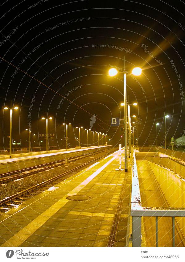 Warm-Cold Platform Physics Light Yellow Night Street lighting CeBIT Hannover Railroad tracks Calm Warmth Wait