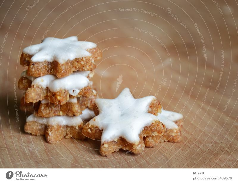 Christmas & Advent Food Nutrition Cooking & Baking Sweet Star (Symbol) Delicious Candy Baked goods Stack Dough Cookie Christmas biscuit Cinnamon Star cinnamon biscuit Icing