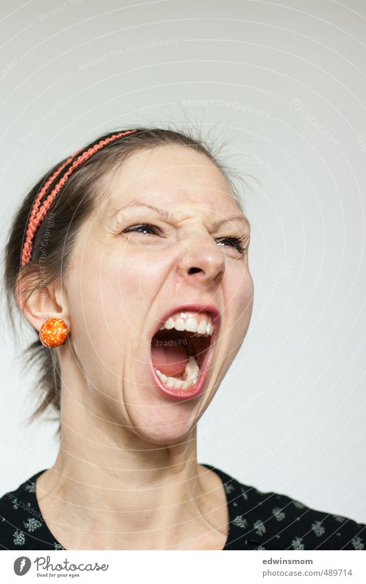 Angry. Feminine Woman Adults Face Eyes Nose Mouth 1 Human being 30 - 45 years Accessory Earring Hairband Blonde Scream Looking Argument Aggression Creepy
