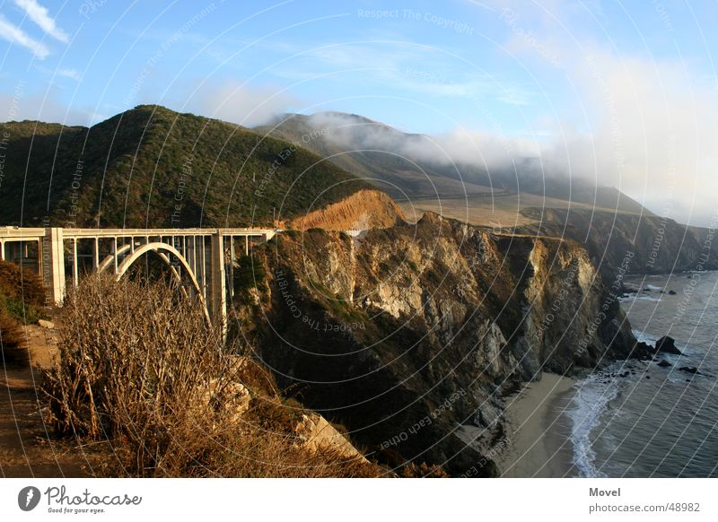 Sky Sun Ocean Beach Vacation & Travel Clouds Far-off places Mountain Coast Fog Bridge USA Vantage point Highway Americas West Coast