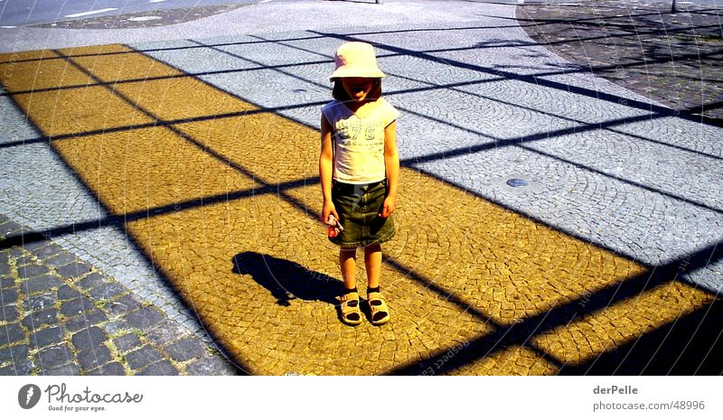 Orange Sun Child Light Cap Structures and shapes Places Shadow Cobblestones Brash