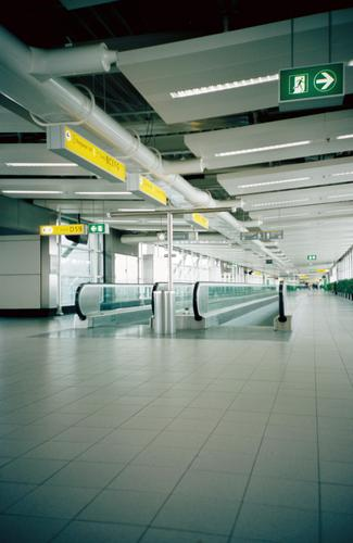 schiphol airport amsterdam Schiphol airport Netherlands Moving pavement Building Empty Loneliness Airplane Covers (Construction) Signs and labeling Airport