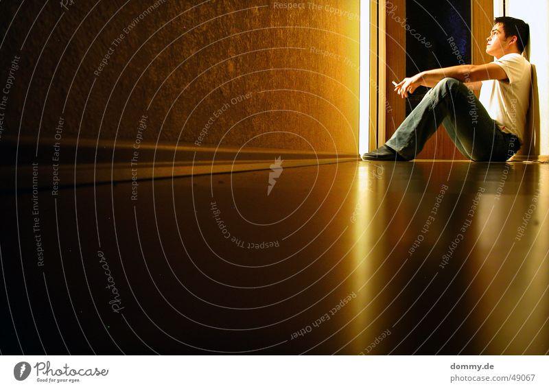 Man Lamp Relaxation Sadness Think Room Door Sit Grief Bathroom T-shirt Floor covering Pants Cigarette Hallway Parquet floor