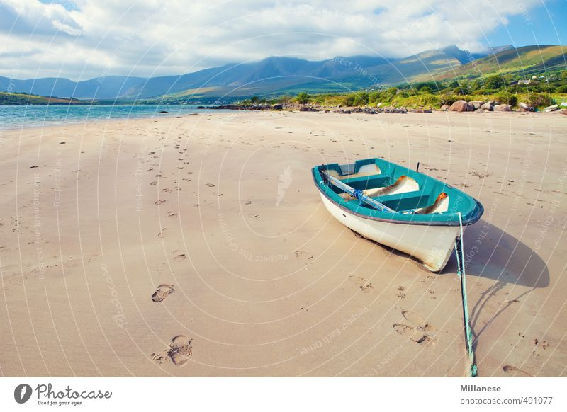 boat by the sea Landscape Coast Ocean Longing Watercraft Ireland Sandy beach Low tide Stranded Blue Mountain Colour photo Exterior shot