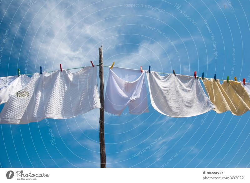 Laundry drying on the rope outside on a sunny day Sky Blue White Colour Sun Red Bright Line Air Wind Fresh Clothing Energy Rope Clean T-shirt