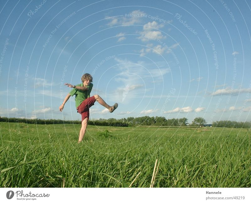 free kick Playing Clouds Meadow Green Masculine Summer Fluid Exterior shot Sky Ball Shot Sun Joy Curl Landscape Nature Freedom