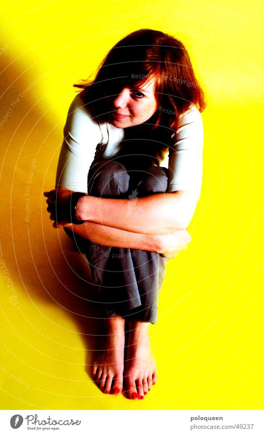 no rest for the wicked Portrait photograph Woman Yellow Red Looking Sit