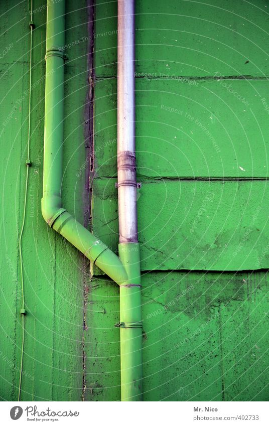 camouflage tube Technology Industrial plant Factory Building Wall (barrier) Wall (building) Facade Green Junction Conduit Effluent Cable Paintwork Hall Dirty