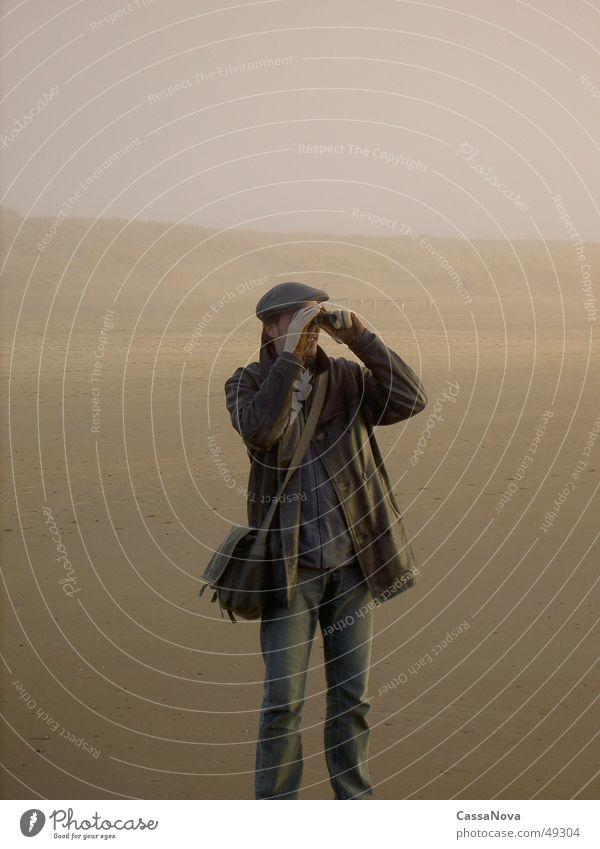 Human being Man Beach Far-off places Sand Fog Binoculars