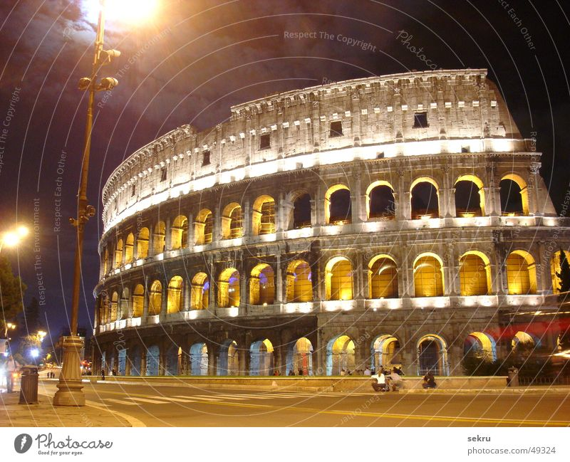 colossally Colosseum Rome Night Lighting Long exposure Dark Italy Historic Building Ruin Evening Impressive Might Lamp Street lighting Clouds Large