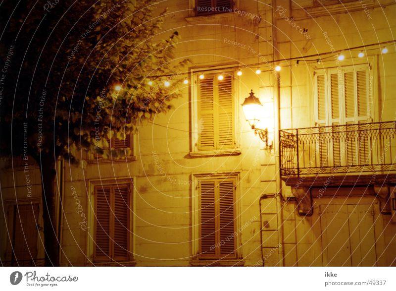Calm House (Residential Structure) Yellow Lamp Wall (building) Window Facade Sleep Lantern Balcony Handrail Shutter Night shot Fairy lights Disk Midnight